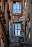View of the passage old ruined building. View of the passage of old ruined buildings with windows, background royalty free stock photography