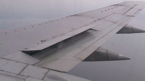 View from the Passenger Airplane Window on the Wing Flying above the Clouds stock video