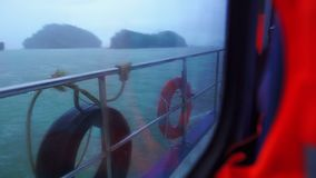 View from the passenger boat window, rainy day stock footage