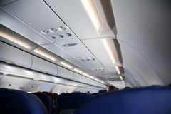View from passenger place in airplane. Interior view of economy coach seats. stock photo