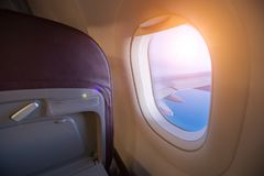 View from passenger`s seat in airplane flying above clouds in dr stock photo