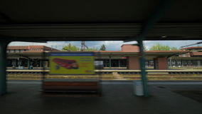 View from passenger train on the railroad tracks and a passing train. VIENNA, AUSTRIA - APRIL 26, 2016: The view from the window of passenger train on the stock video footage
