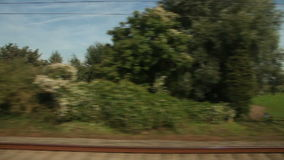 View of passing landscape. Belgium, Europe. View of passing landscape from a train window. Belgium, Europe stock footage