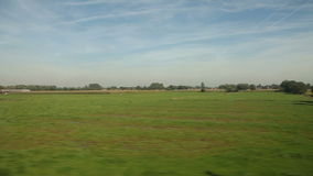 View of passing landscape. From a train window stock footage