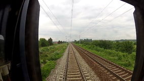 View of passing landscape from a train window. View of passing landscape from train window stock video footage