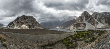 View of Passu, Pakistan. Passu is a small village on the Karakoram Highway, beside the Hunza River, some 15 kilometers from Gulmit, the Tehsil headquarters of Stock Image