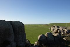 A view of pasture land from Elephant Rocks above Dillon Beach California. Green fields and blue sky stock photo