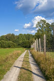 View of a path with a fence in the green countryside in Sweden Stock Photography