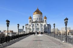 View of the Patriarchy Patriarchal Pedestrian Bridge and the Cathedral of Christ the Savior in March royalty free stock image