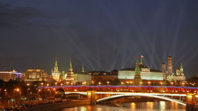 View from the Patriarshiy bridge. Spotlights over the Moscow Kremlin. stock video