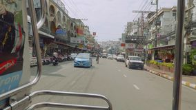 View of Pattaya streets from window of moving sangteo stock footage
