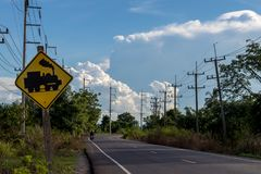 View of rural road with warning signs across the railway. Royalty Free Stock Images