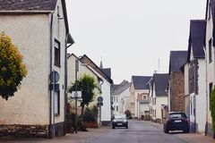 View of the paved street with traditional medieval houses royalty free stock photos