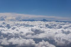 Mountain peaks above clouds stock photos