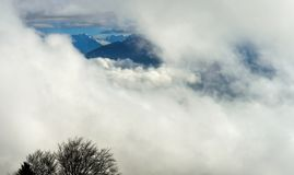 View on peaks of the Frewnch Alps through a hole in the clouds Stock Image