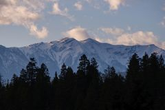 View of the peaks of the Rocky Mountains from Golden, BC, Canada. Detail of the peaks of the Rocky Mountains at sunset time from Golden, BC, Canada stock photos