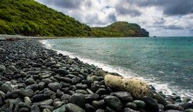 Pebble Beach on Caribbean Island, St. John. A view of a pebble beach on the Caribbean island of St. John, Virgin Islands. Saltpond Bay, Ram`s Head peninsula in stock image