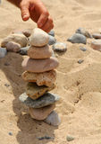 View of the pebbles stack. On the sand Royalty Free Stock Photos