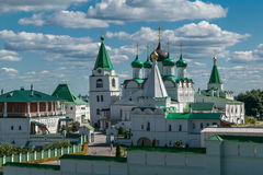 View at Pechersky ascension monastery a clear Sunny day. View at Pechersky ascension monastery white clear Sunny day. Is a Church with a bell tower and gold Royalty Free Stock Photography