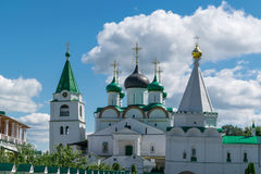 View at Pechersky ascension monastery a clear Sunny day. View at Pechersky ascension monastery white clear Sunny day. Is a Church with a bell tower and gold Stock Images