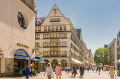 View of the pedestrian street of Neuhauser in centre of Munich. Bavaria. MUNICH, GERMANY - JUNE 7, 2016: View of the pedestrian street of Neuhauser in centre of Royalty Free Stock Images