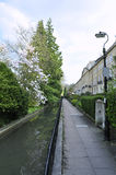 View of a Pedestrian Walkway. View of a Pavement, Stream and a Row of Houses in London Stock Photography