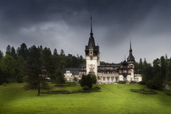 View of Peles Castle during a storm in summer Stock Image