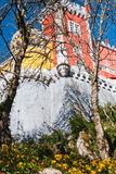 View of the Pena Palace. View from the park. The castle is on top. Tall trees Royalty Free Stock Images