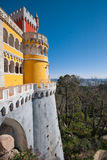 View of the Pena Palace. View from the park. The castle is on top. Tall trees Stock Photography