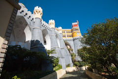 View of the Pena Palace. View from the park. The castle is on top. Tall trees Royalty Free Stock Photos