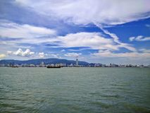 View of penang island from the sea. View of penang island approaching from a ferry Royalty Free Stock Photo