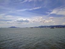 View of penang island from the sea. View of penang island approaching from a ferry Stock Photos