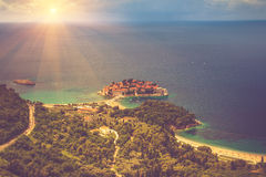View of the peninsula of Sveti Stefan from the height of the mountains. Montenegro. Adriatic Sea. Royalty Free Stock Image