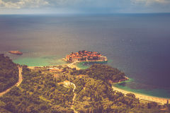 View of the peninsula of Sveti Stefan from the height of the mountains. Montenegro. Adriatic Sea. Royalty Free Stock Photos