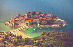 View of the peninsula of Sveti Stefan from the height of the mountains. Montenegro. Adriatic Sea. Stock Photos