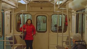 View of people in carriage of metro train. View of people in carriage of metro train in Moscow stock footage