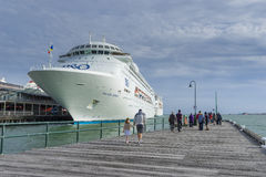 View of people and cruise ship in the pier Royalty Free Stock Images