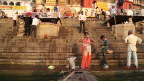 View on people at ghats of the Ganges river from the water. VARANASI, INDIA - 22 FEBRUARY 2015: View on people at ghats of the Ganges river from the water stock video footage