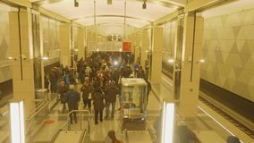 Moscow - circa April, 2018: View of people on platfromm of metro station. Camera goes goes down. View of people on platfromm of metro station in Moscow. Camera stock video