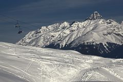A view of people on ski lifts and mountains in the alps Switzerland Royalty Free Stock Photo