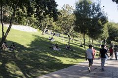 View of people walking, hanging out. On grass ground at park in Nisantasi / Istanbul in sunny summer day Royalty Free Stock Images