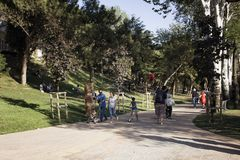 View of people walking, hanging out on grass. Ground at park in Nisantasi / Istanbul in sunny summer day Stock Photos