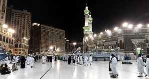 View of people walking to Masjidil Haram Mosque in Makkah City at night, during umrah season. stock image