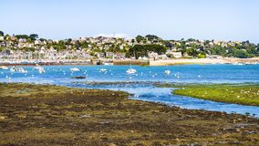 View of Perros-Guirec commune through estuary. Travel to France - view of Perros-Guirec commune through estuary of river Kerduel and bay Anse de Perros in Cotes Royalty Free Stock Photography