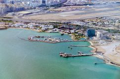 View from the Persian Gulf to the runway of Hamad International Airport. Doha, Qatar royalty free stock images