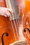 View of person playing double bass on the street.  royalty free stock photos