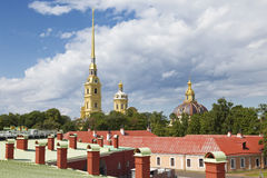 View of the Peter and Paul Cathedral and the roofs of the same name fortress. Saint-Petersburg, Russia stock photography