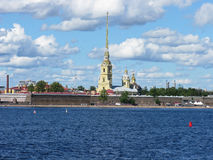 View of the Peter and Paul fortress. The Neva river. Saint Petersburg, Russia. View of the Peter and Paul fortress and the Neva river.  Peter and Paul cathedral Royalty Free Stock Photography