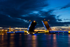 View on the Peter and Paul fortress and raised Palace bridge in summer white nights, St. Petersburg Stock Photo