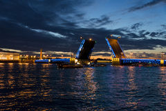 View on the Peter and Paul fortress and raised Palace bridge in summer white nights, St. Petersburg Royalty Free Stock Photography